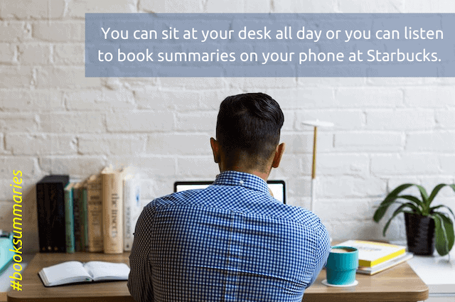 man at desk with lots of books